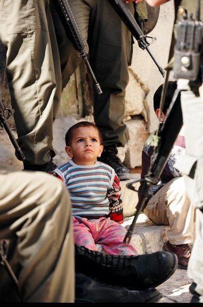 Little Child watching Occupatying Soldiers