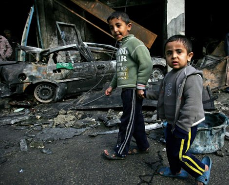 Children in Gaza walking aside a by Israel airattacks demolished mosque