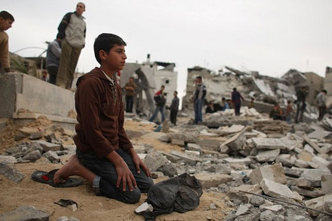 Also Palestine's children, never give up… A boy, in prayer….