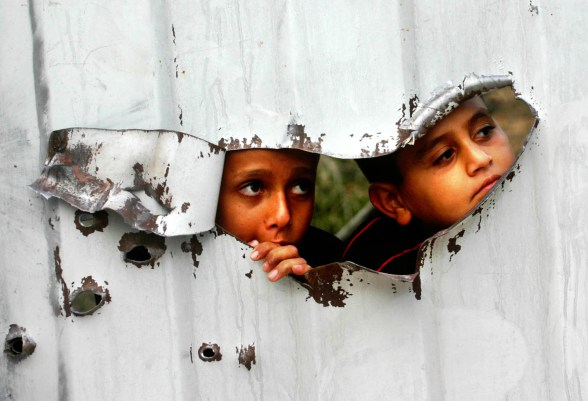 Palestinian kids looking through
