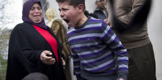 A Palestinian child's reaction after seeing his family home being demolished by israel